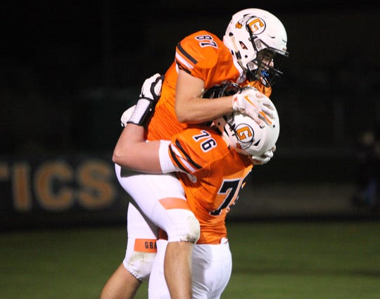 Grafton tight end Caleb Buback (87) celebrates his touchdown catch with offensive lineman JP Benzschawel in a game against Hartford on Sept. 28.