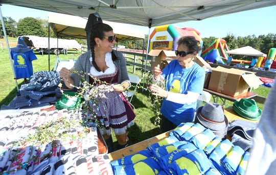 Jaime Goodrich,,l, of Mendham and Arline Rossi of Chester with flower crowns at the Chester Lions annual Oktoberfest celebration at Chubb Park in Chester. September 29, 2018, Chester, NJ