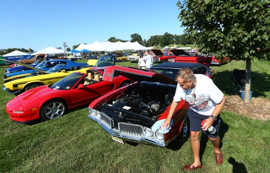 Stephen Scypinski of Chester shines up his '70 Oldsmobile 442, part of the Chester Lions annual Oktoberfest celebration at Chubb Park in Chester. September 29, 2018, Chester, NJ