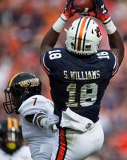 Auburn's Seth Williams (18) catches a pass and runs into the end zone for a touchdown at Jordan-Hare Stadium in Auburn, Ala., on Saturday, Sept. 29, 2018. Auburn leads Southern Miss 14-3, the game went into a weather delay with 4:27 left in the second quarter.