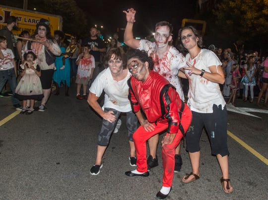 """Zombie Michael Jackson joined the """"Thriller"""" dancers at the prom. There were many kinds of dead walking in downtown Montgomery on Friday, Sept. 28, 2018, for  Montgomery Zombie Walk and Prom, which collected food and money donations for the Montgomery Area Food Bank."""