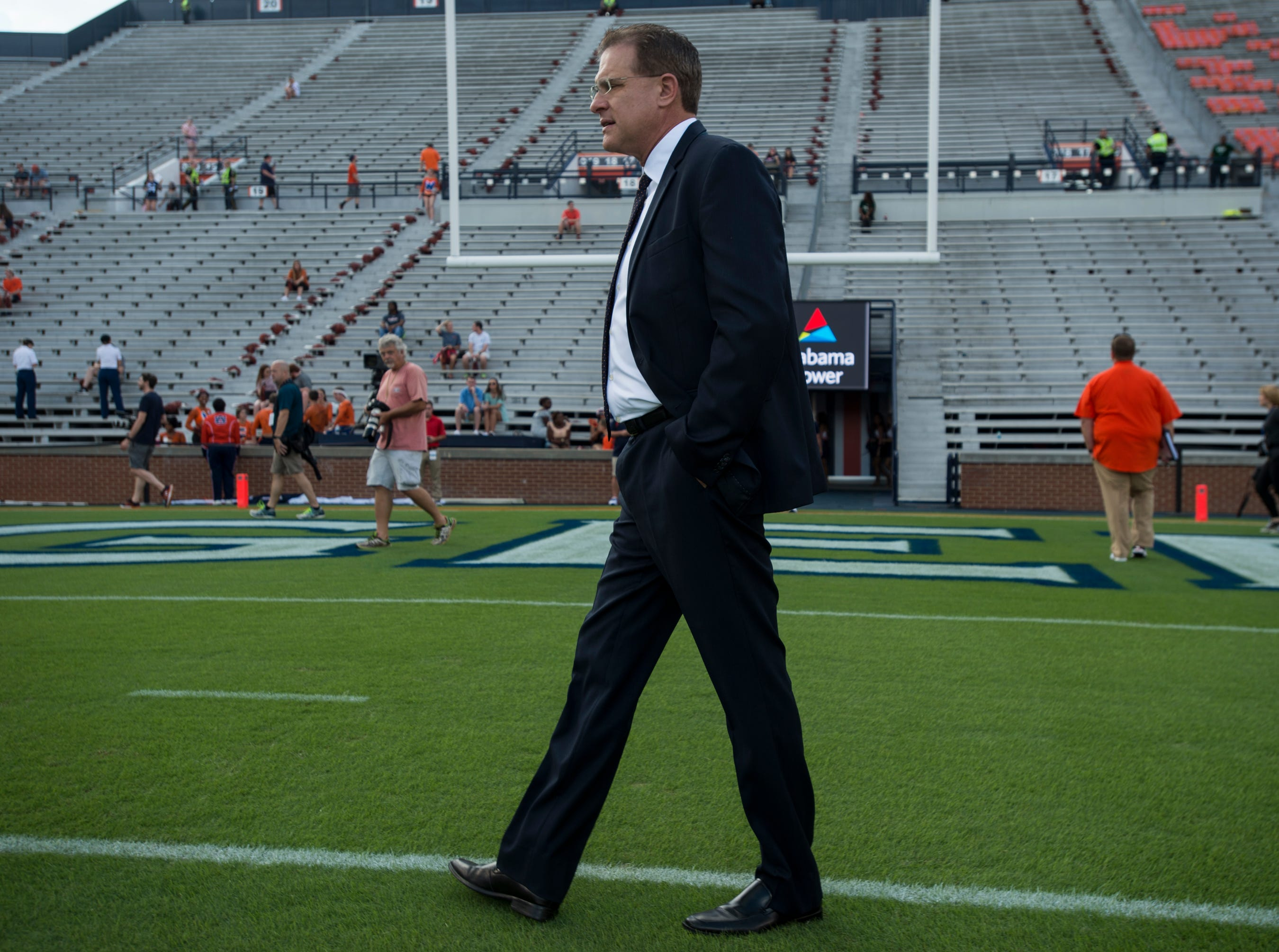 Auburn head coach Gus Malzahn walks on to the field with his team following the Tiger Walk at Jordan-Hare Stadium in Auburn, Ala., on Saturday, Sept. 29, 2018.