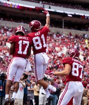 Alabama wide receivers Jaylen Waddle (17) and Derek Kief (81) celebrate Waddles touchdown catch in the second half against Louisiana at Bryant-Denny Stadium in Tuscaloosa, Ala., on Saturday September 29, 2018.
