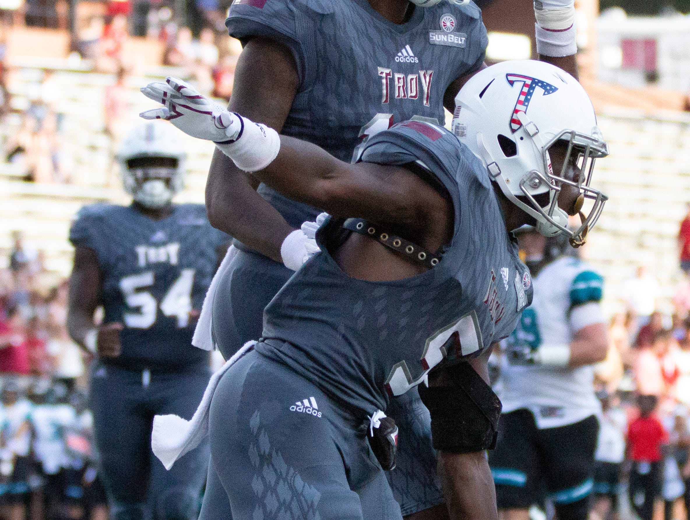Troy's Jabir Daughtry-Frye celebrates a touchdown during the fourth quarter.