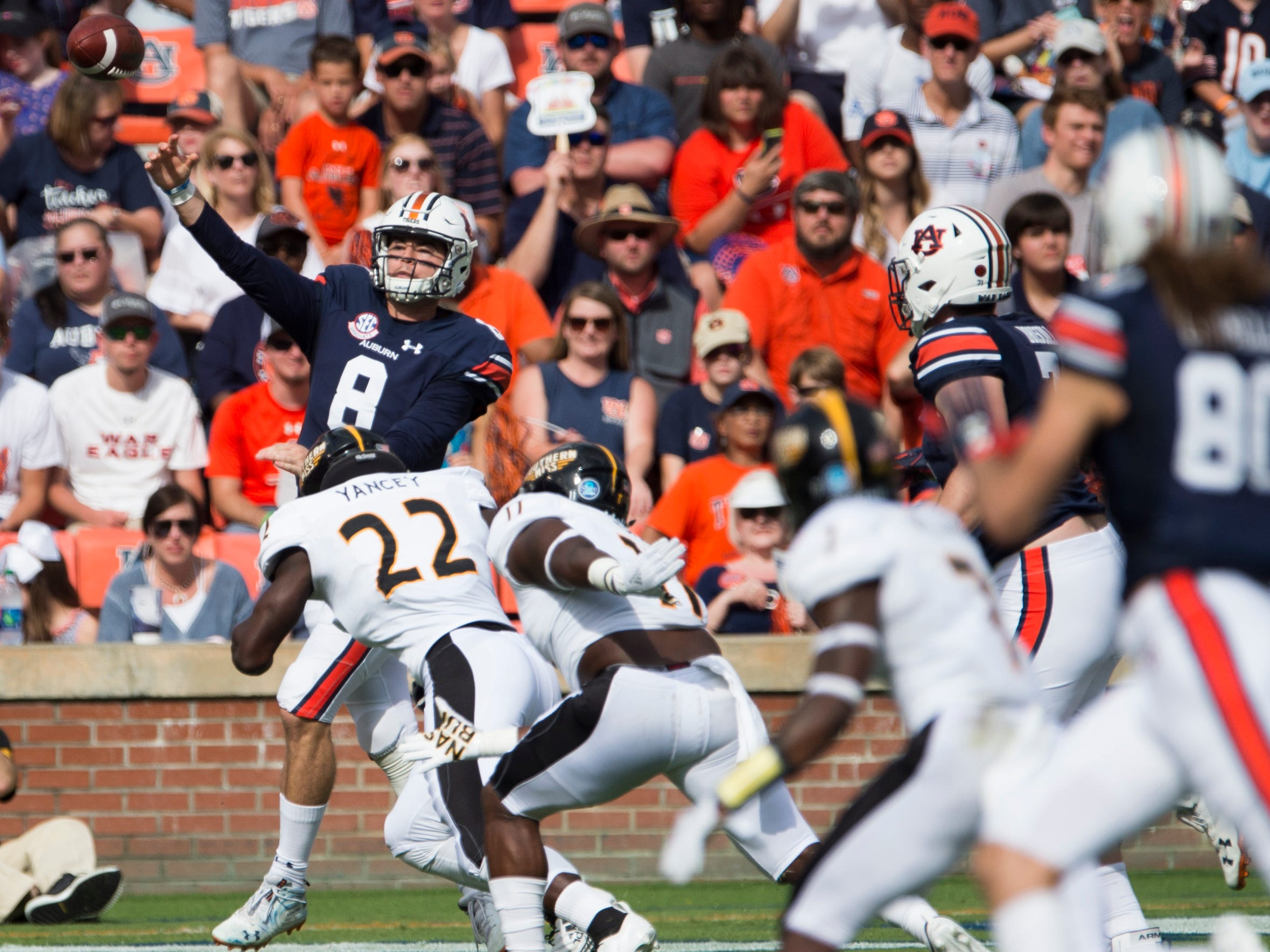 Auburn's Jarrett Stidham (8) throws the ball under pressure against Southern Miss at Jordan-Hare Stadium in Auburn, Ala., on Saturday, Sept. 29, 2018. Auburn leads Southern Miss 14-3, the game went into a weather delay with 4:27 left in the second quarter.
