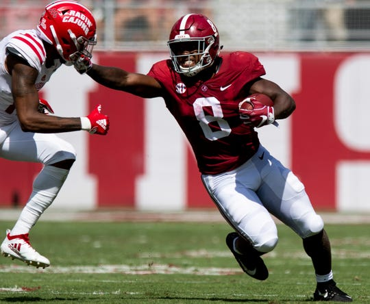 Alabama running back Josh Jacobs (8) stiff arms Louisiana defensive back Michael Jacquet, III, (11) in first half action at Bryant-Denny Stadium in Tuscaloosa, Ala., on Saturday September 29, 2018.