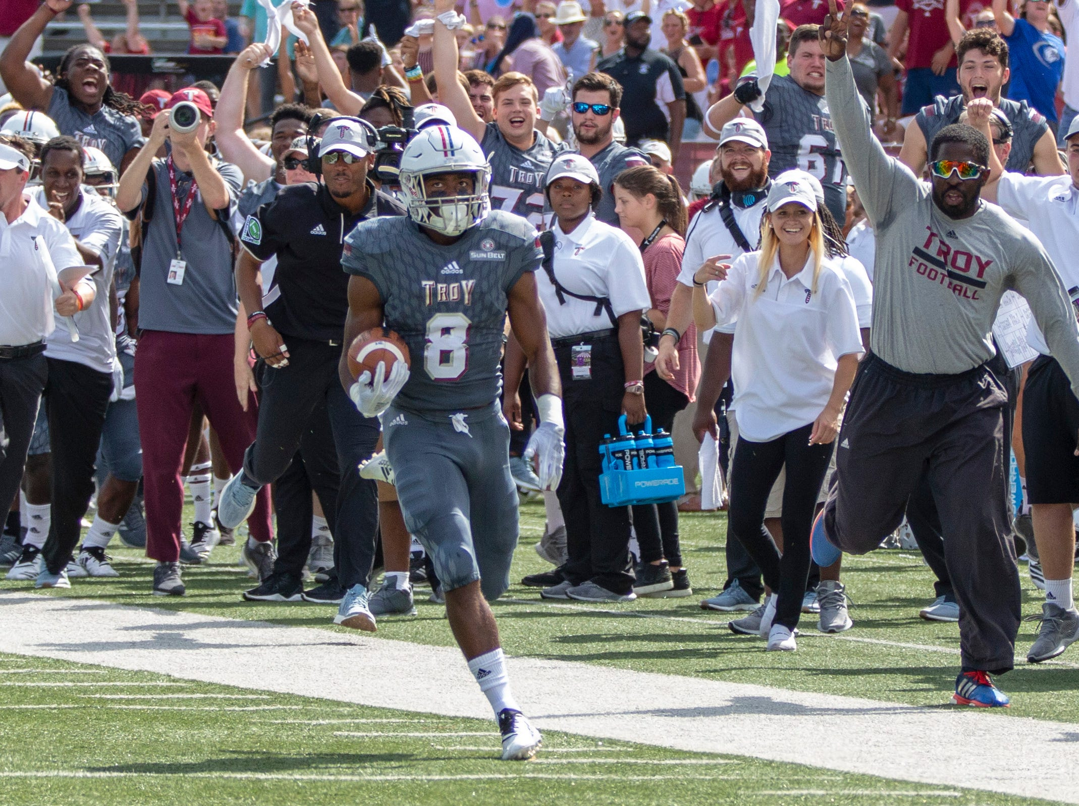 Troy's Marcus Jones returns the kickoff for a touchdown against Coastal Carolina.
