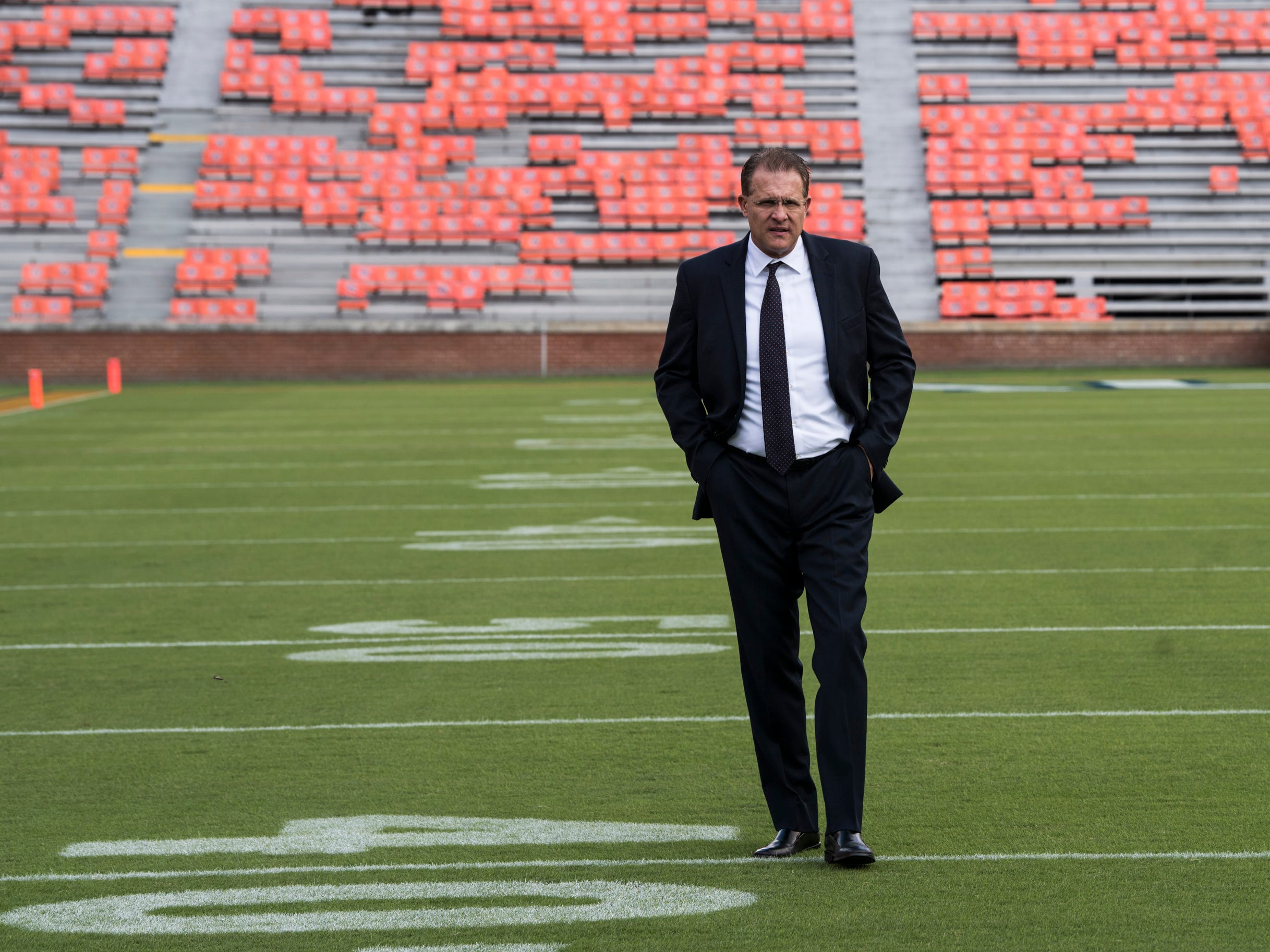 Auburn head coach Gus Malzahn walks on to the field with his team following the Tiger Walk at Jordan-Hare Stadium in Auburn, Ala., on Saturday, Sept. 29, 2018.