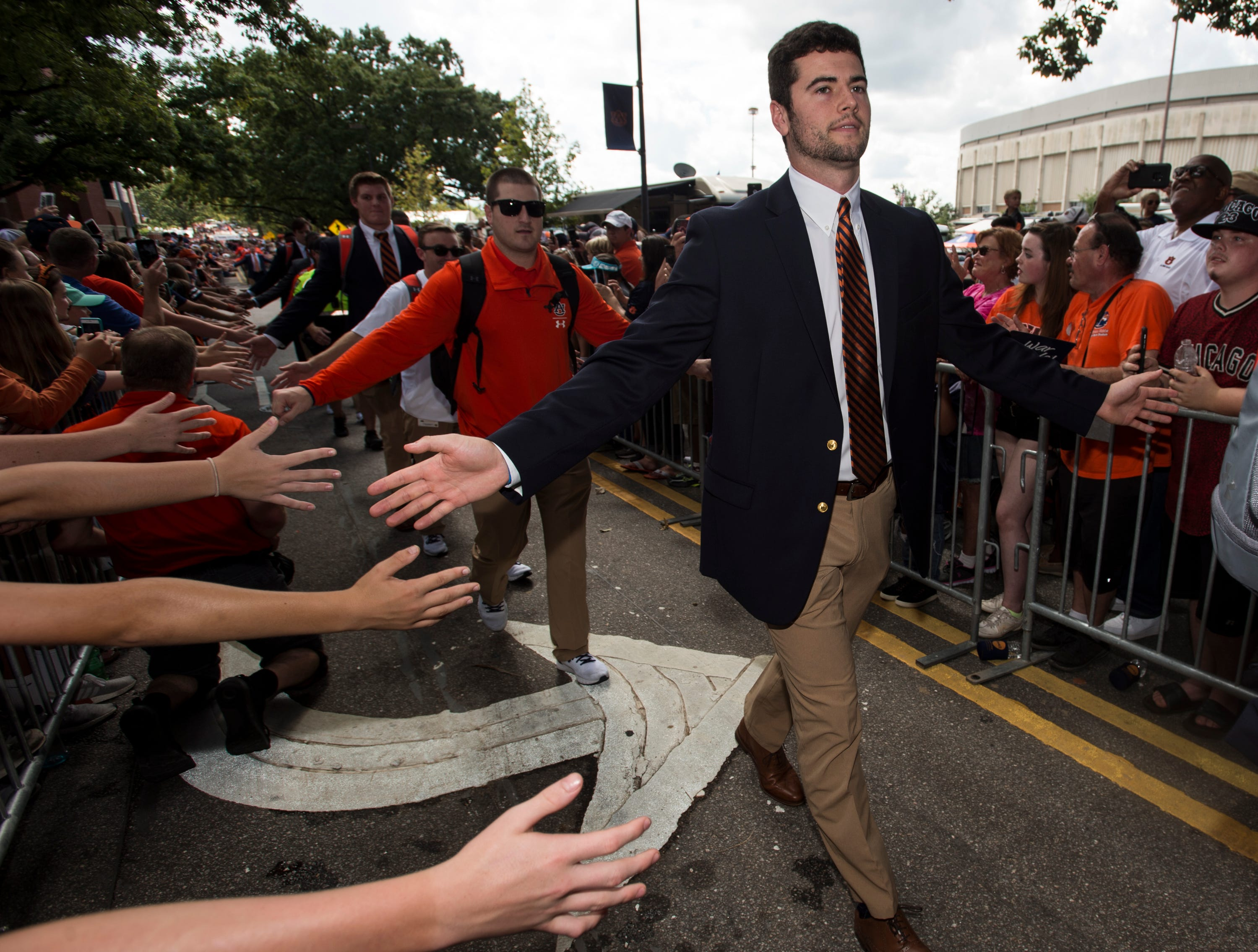 Auburn's Jarrett Stidham high fives fans during the Tiger Walk outside Jordan-Hare Stadium in Auburn, Ala., on Saturday, Sept. 29, 2018.