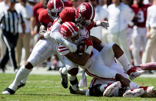 Alabama linebacker Mack Wilson (30) tackles Louisiana running back Trey Ragas (9) in first half action at Bryant-Denny Stadium in Tuscaloosa, Ala., on Saturday September 29, 2018.