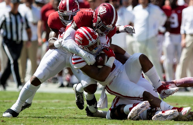 UL running back Trey Ragas is brought down by Alabama linebacker Mack Wilson (30) in Saturday's 56-14 loss to the No. 1 Crimson Tide in Tuscaloosa. Ragas finished with 111 rushing yards and one touchdown.