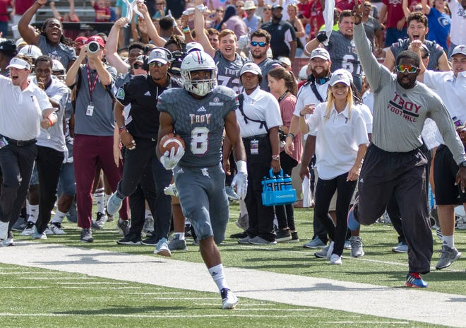 Troy's Marcus Jones returns the opening kickoff for a touchdown against Coastal Carolina.