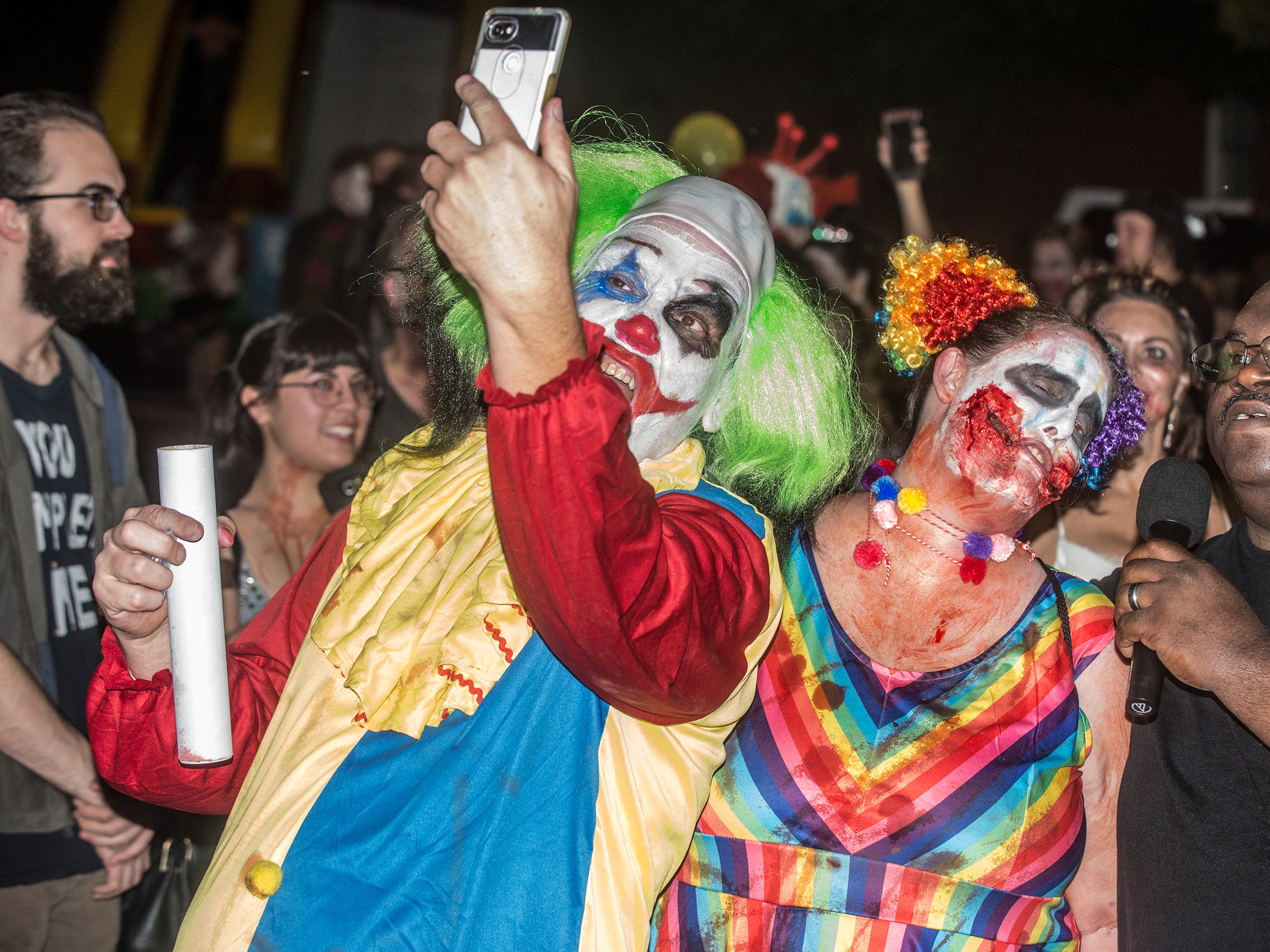 Do evil clowns take selfies? These do. There were many kinds of dead walking in downtown Montgomery on Friday, Sept. 28, 2018, for  Montgomery Zombie Walk and Prom, which collected food and money donations for the Montgomery Area Food Bank.
