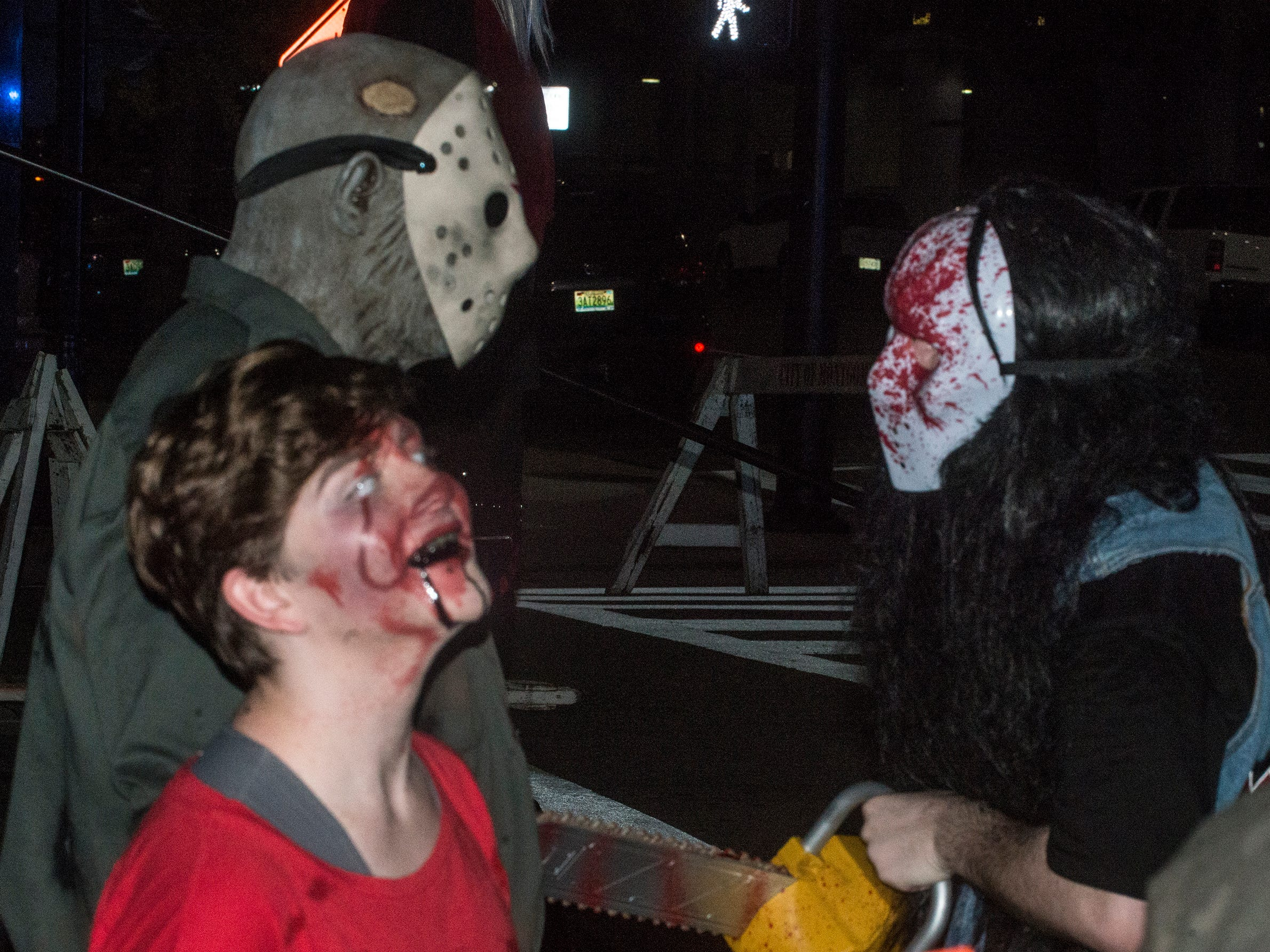 It's Jason vs. bloody masked chainsaw guy. There were many kinds of dead walking in downtown Montgomery on Friday, Sept. 28, 2018, for  Montgomery Zombie Walk and Prom, which collected food and money donations for the Montgomery Area Food Bank.