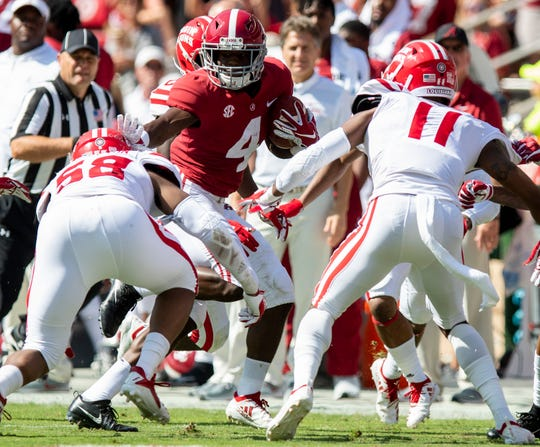 UL linebacker Justin Middleton (58) deals with a stiff arm from Alabama wide receiver Jerry Jeudy (4)  earlier this season.