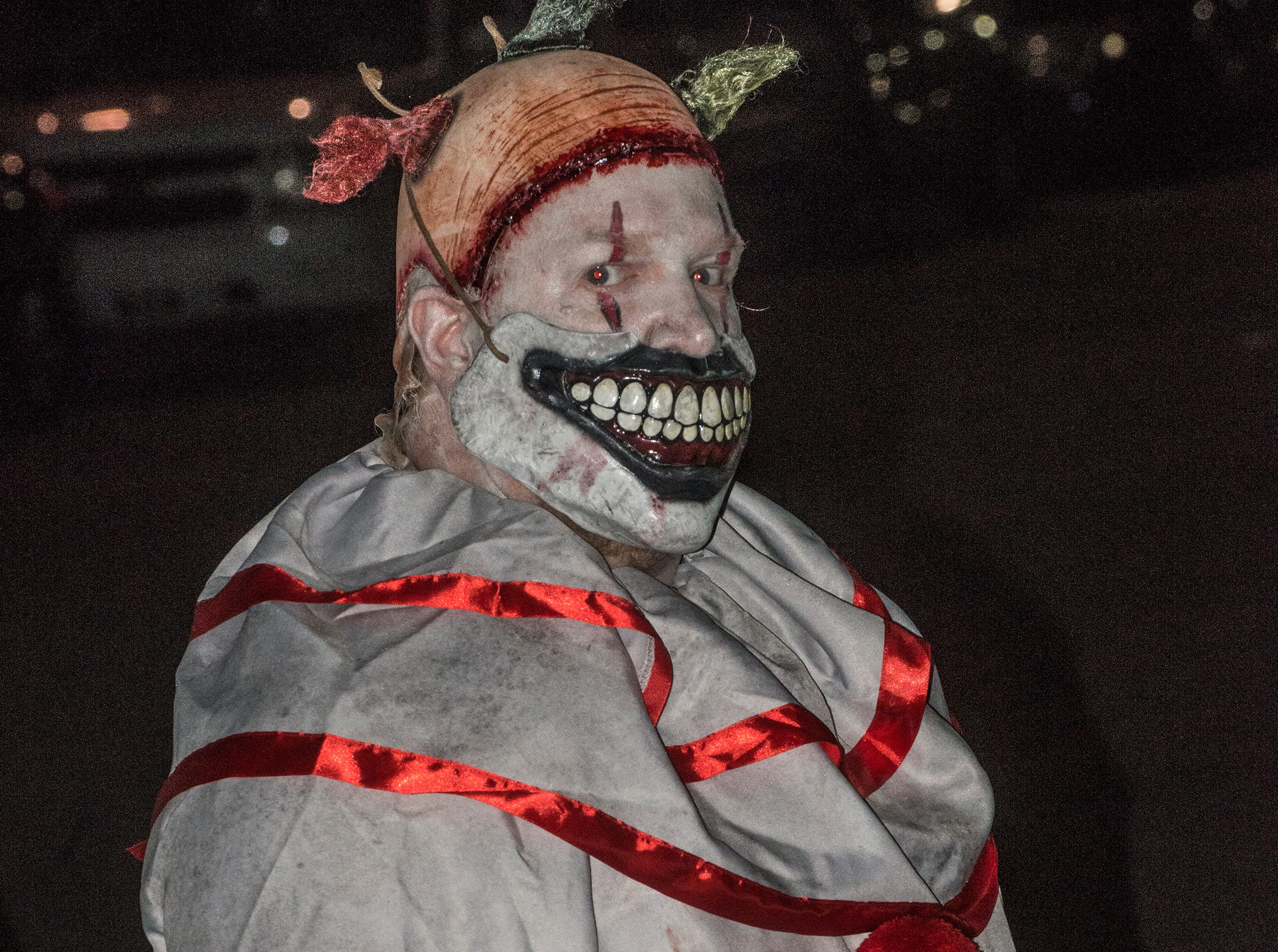 "Twisty the Clown from TV's ""American Horror Story"" showed his face, kind of. There were many kinds of dead walking in downtown Montgomery on Friday, Sept. 28, 2018, for  Montgomery Zombie Walk and Prom, which collected food and money donations for the Montgomery Area Food Bank."