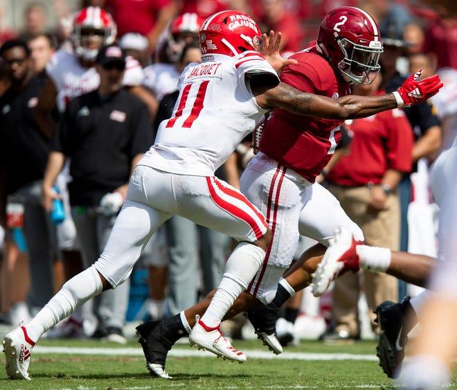 UL's Michael Jacquet tackles Alabama quarterback Jalen Hurts during the Sept. 29 game in Tusacaloosa, Alabama.