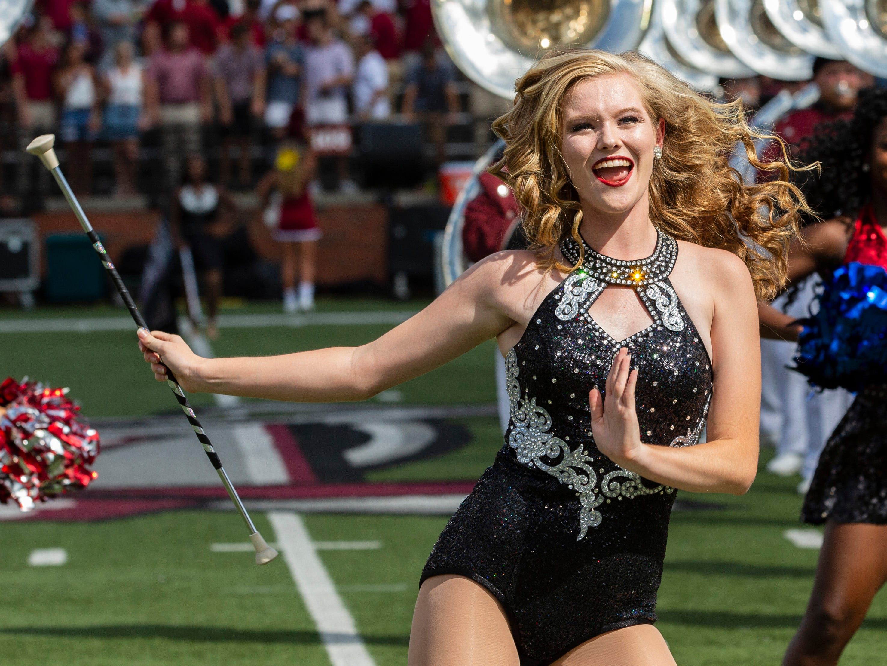 A Troy majorette charms the crowd during pregame.