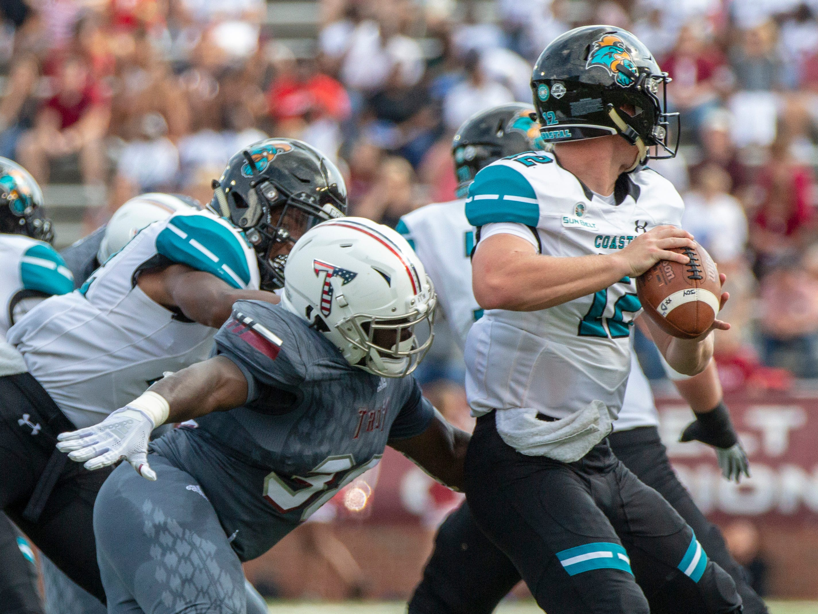Troy's Jeremiah Jones sneaks up on an unsuspecting Bryce Carpenter for a tackle.