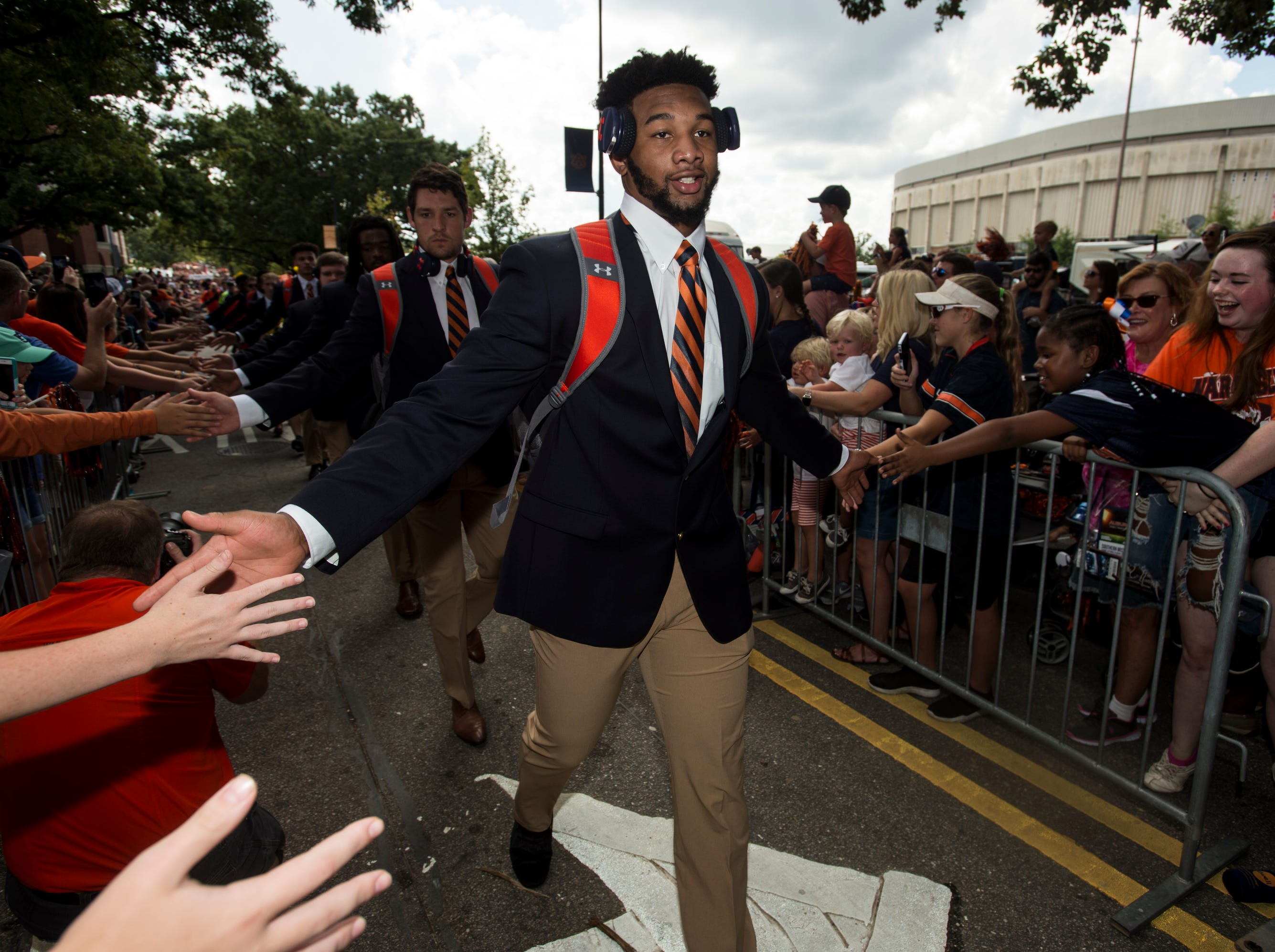 Auburn players high five fans during the Tiger Walk outside Jordan-Hare Stadium in Auburn, Ala., on Saturday, Sept. 29, 2018.