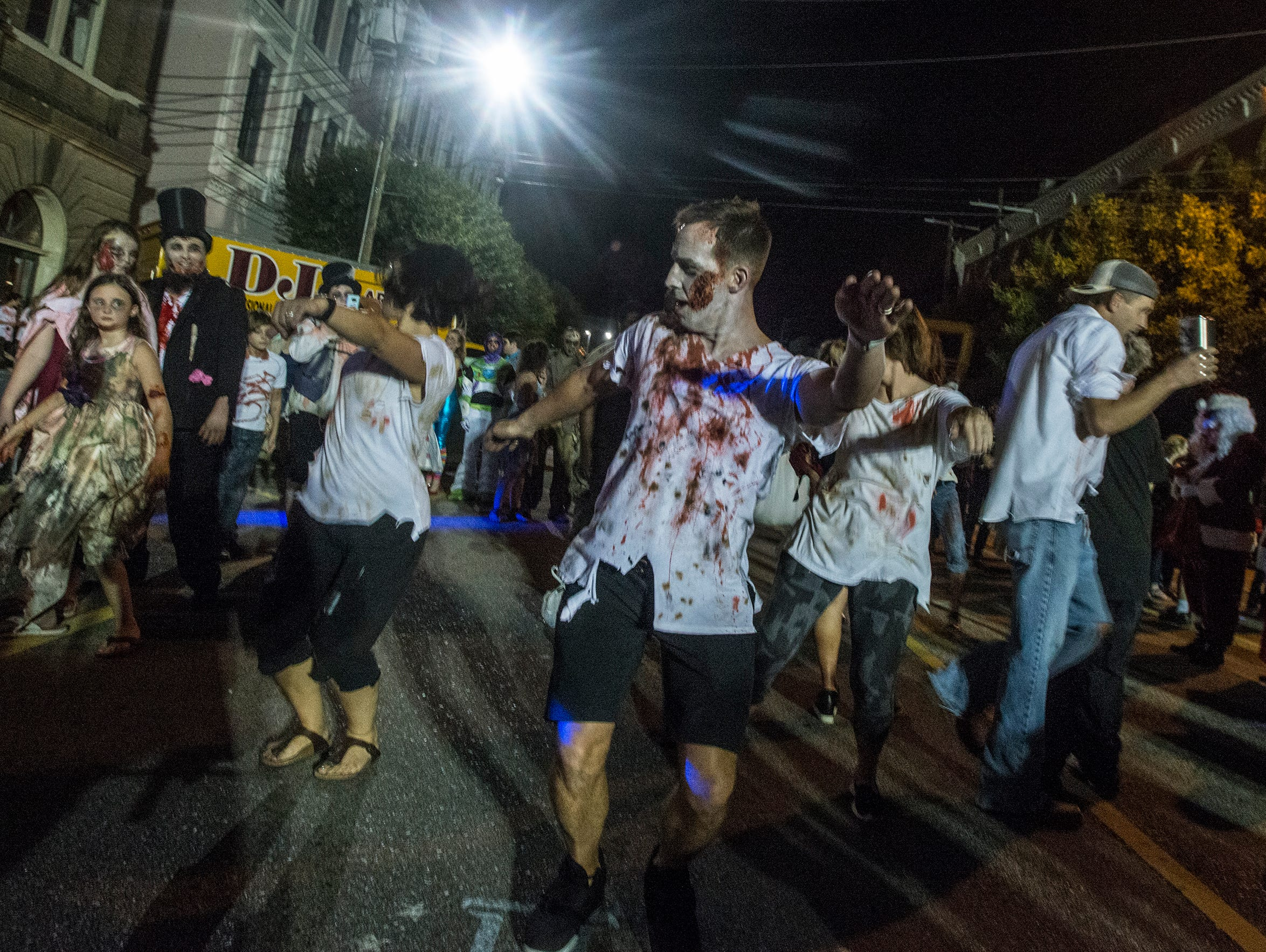 "The ""Thriller"" dancers at the prom. There were many kinds of dead walking in downtown Montgomery on Friday, Sept. 28, 2018, for  Montgomery Zombie Walk and Prom, which collected food and money donations for the Montgomery Area Food Bank."