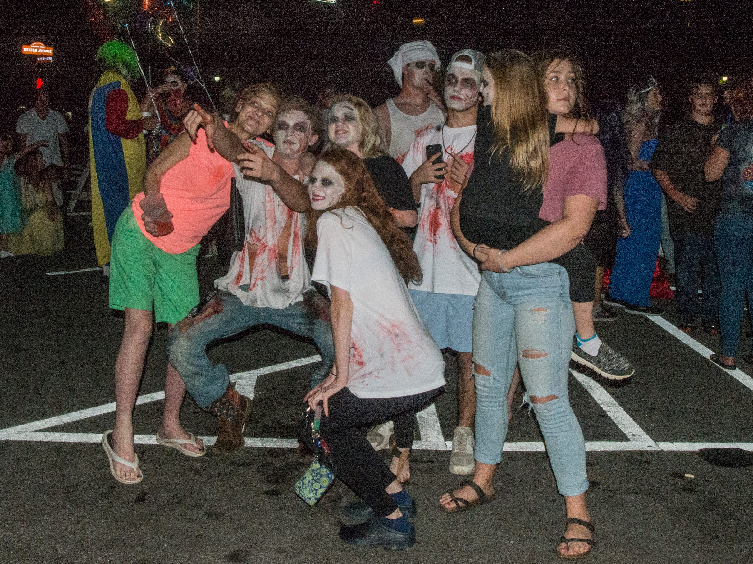 There were many kinds of dead walking in downtown Montgomery on Friday, Sept. 28, 2018, for  Montgomery Zombie Walk and Prom, which collected food and money donations for the Montgomery Area Food Bank.