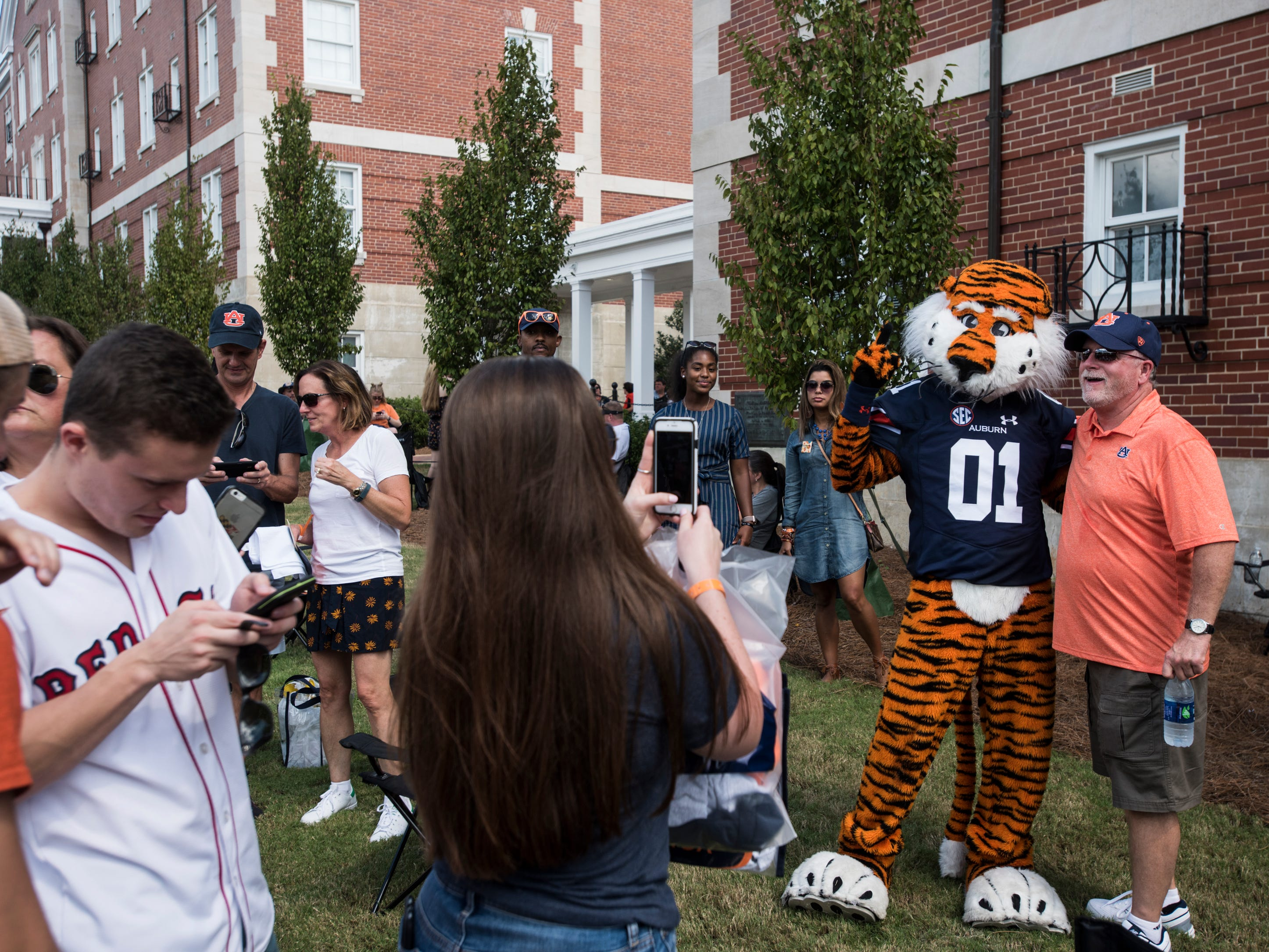 Fans take pictures with Auburn mascot, Aubie, outside Jordan-Hare Stadium in Auburn, Ala., on Saturday, Sept. 29, 2018.