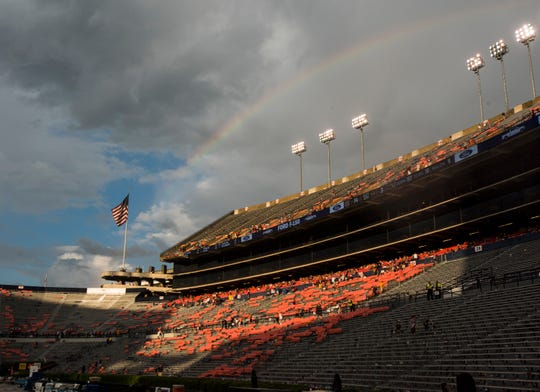 The sun comes out and a rainbow is seen as fans and players wait for a weather delay at Jordan-Hare Stadium in Auburn, Ala., on Saturday, Sept. 29, 2018.