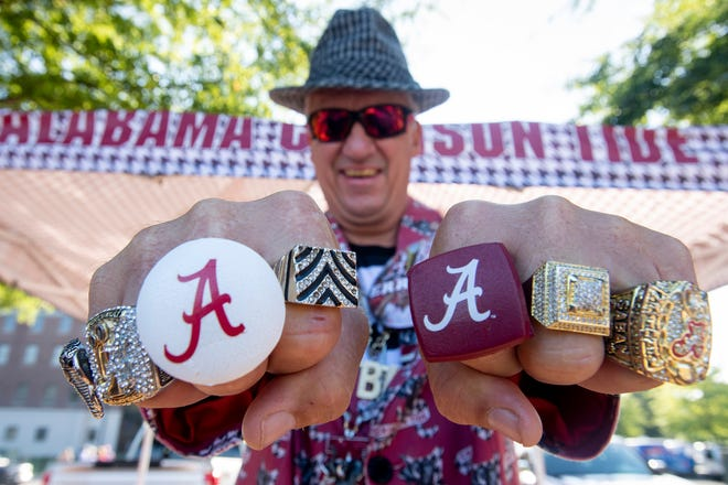 Alabama fan Robin Albano, of Decatur is dressed for the game in Tuscaloosa, Ala., on Saturday September 29, 2018.