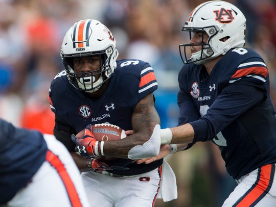 Auburn's Jarrett Stidham (8) hands the ball off to Auburn's Kam Martin (9) at Jordan-Hare Stadium in Auburn, Ala., on Saturday, Sept. 29, 2018. Auburn leads Southern Miss 14-3, the game went into a weather delay with 4:27 left in the second quarter.