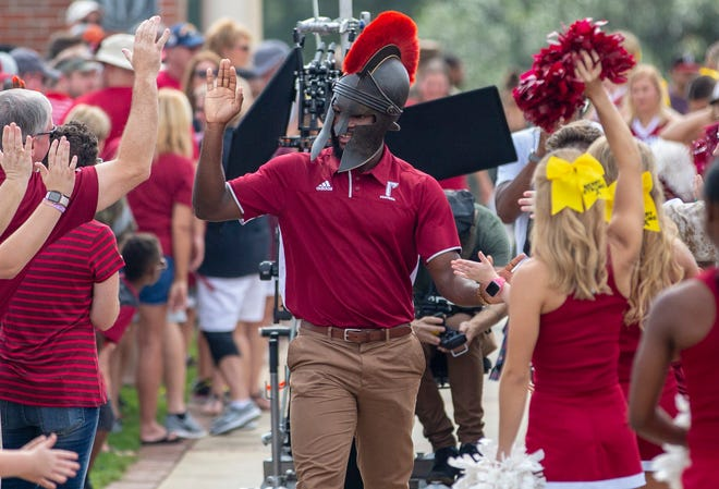 A Troy student riles up the crowd for a commercial.