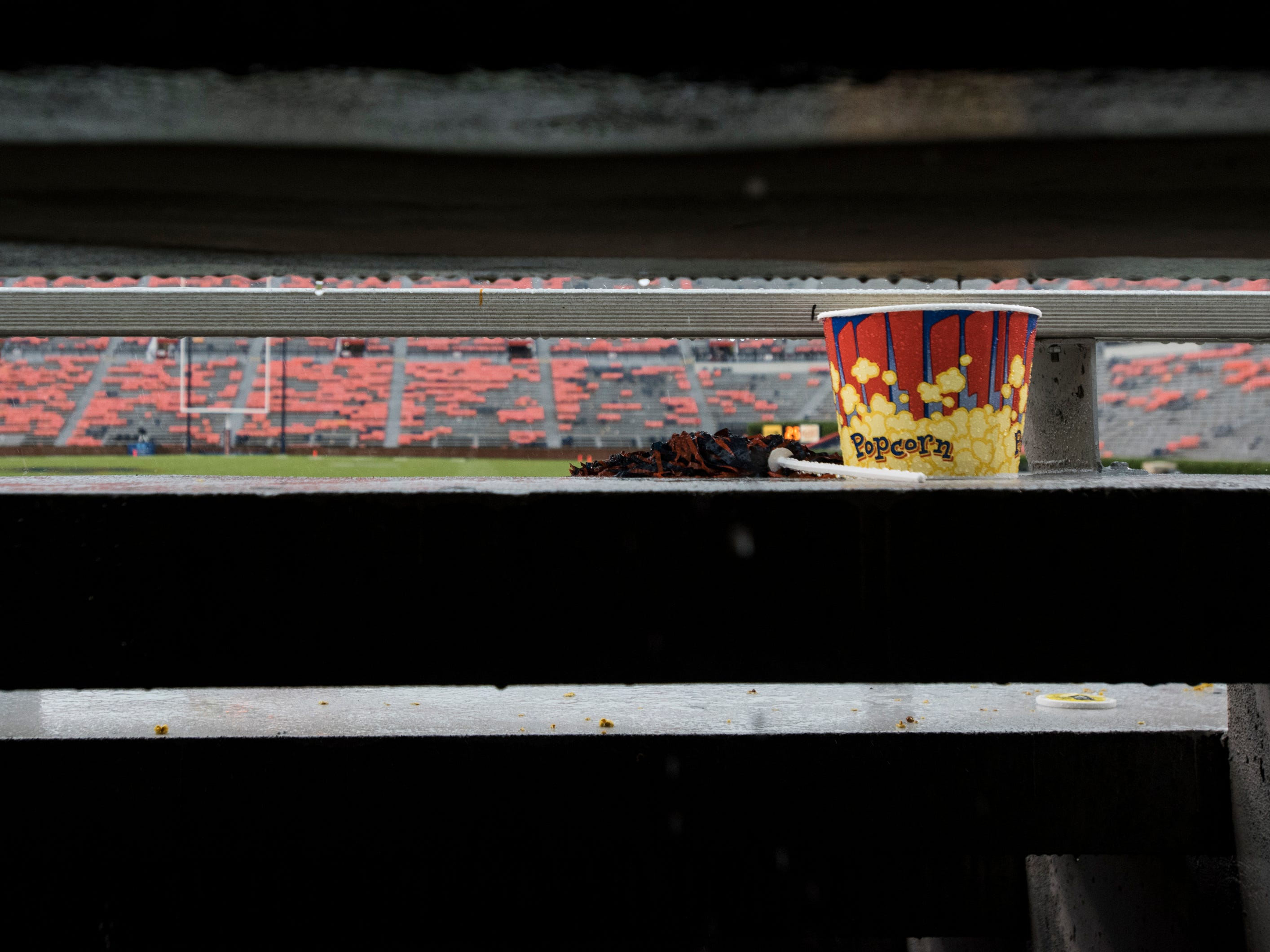 A pom-pom and popcorn tub is left behind in the bleachers at Jordan-Hare Stadium in Auburn, Ala., on Saturday, Sept. 29, 2018. Auburn leads Southern Miss 14-3, the game went into a weather delay with 4:27 left in the second quarter.