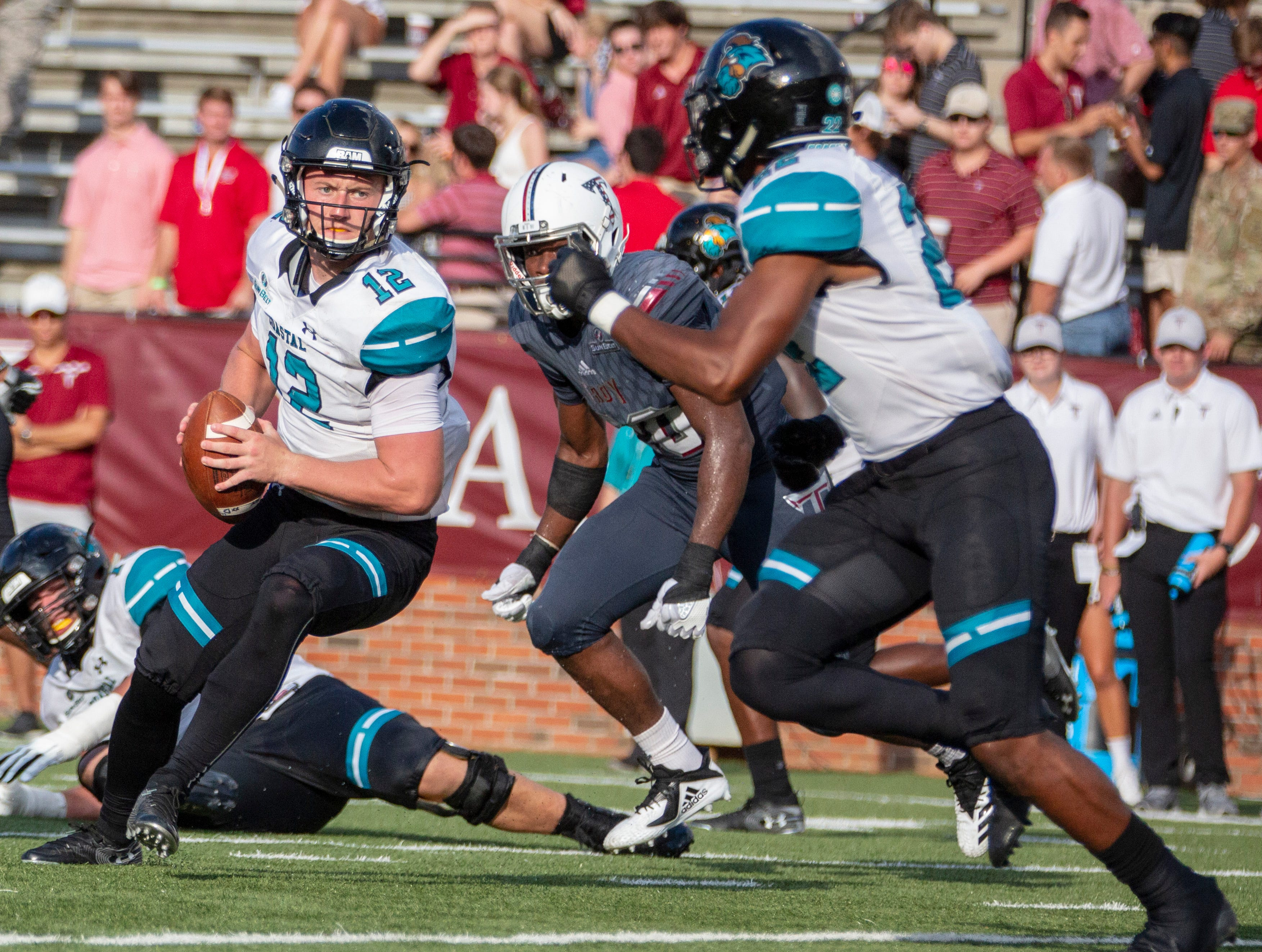 Coastal Carolina's Bryce Carpenter drops back to get eyes on his receiver.