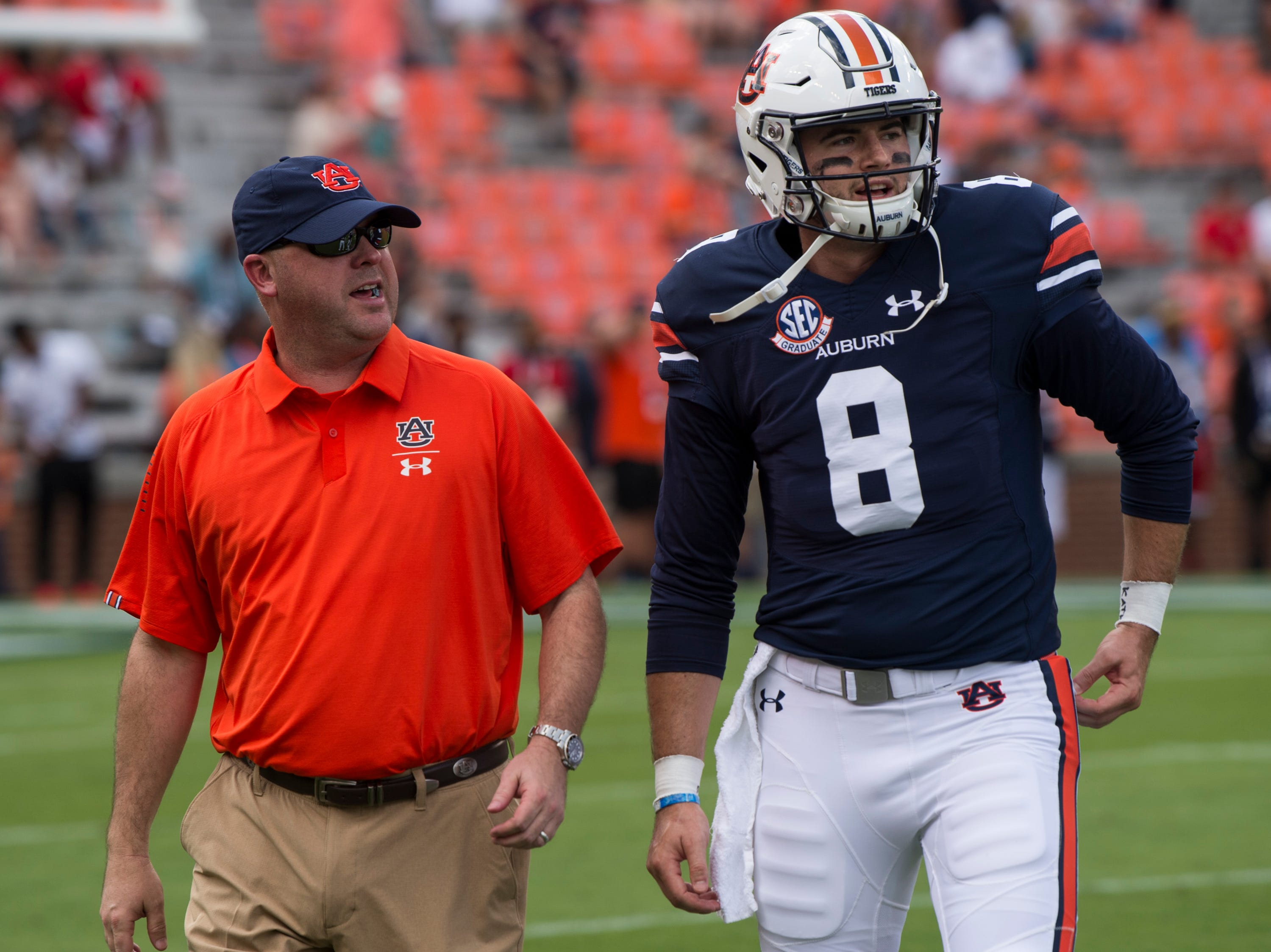 Auburn offensive coordinator Chip Lindsey talks with quarterback Jarrett Stidham (8) during warm ups before taking on Southern Miss at Jordan-Hare Stadium in Auburn, Ala., on Saturday, Sept. 29, 2018.
