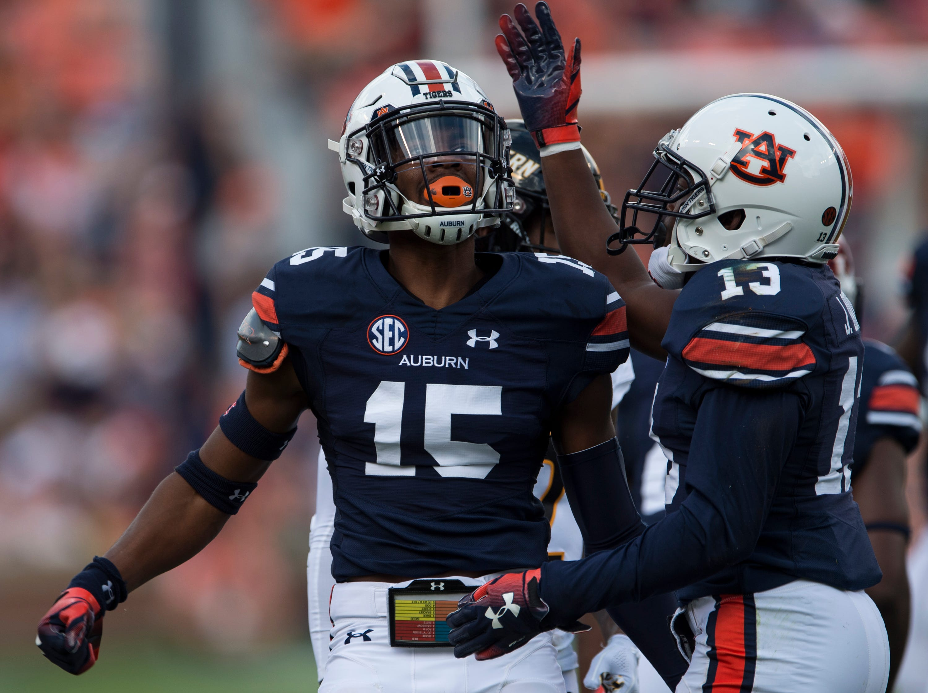 Auburn's Jordyn Peters (15) celebrates a tackle with Javaris Davis (13) at Jordan-Hare Stadium in Auburn, Ala., on Saturday, Sept. 29, 2018. Auburn leads Southern Miss 14-3, the game went into a weather delay with 4:27 left in the second quarter.