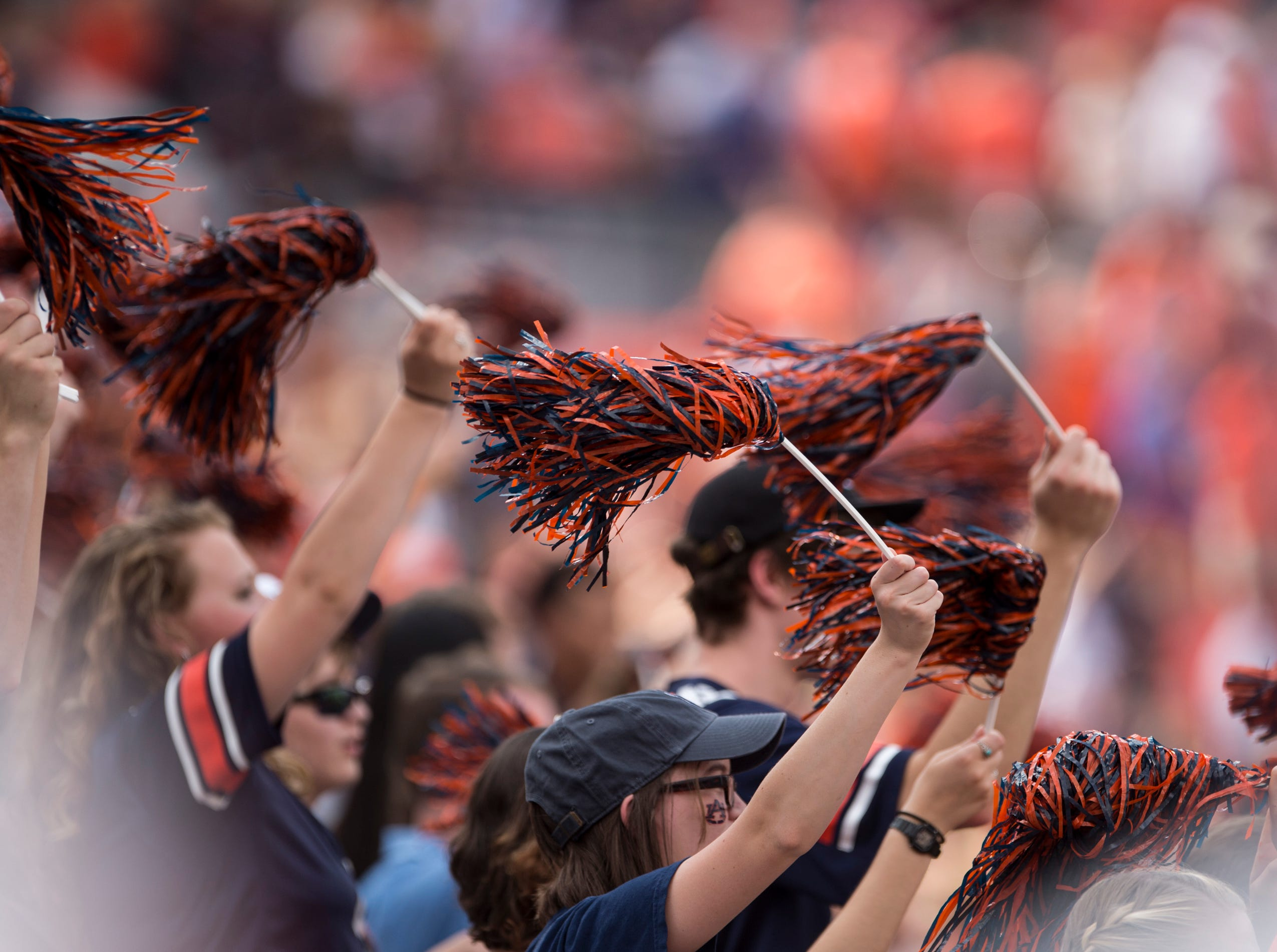 Fans wave pom-poms during the start of the game at Jordan-Hare Stadium in Auburn, Ala., on Saturday, Sept. 29, 2018. Auburn leads Southern Miss 14-3, the game went into a weather delay with 4:27 left in the second quarter.