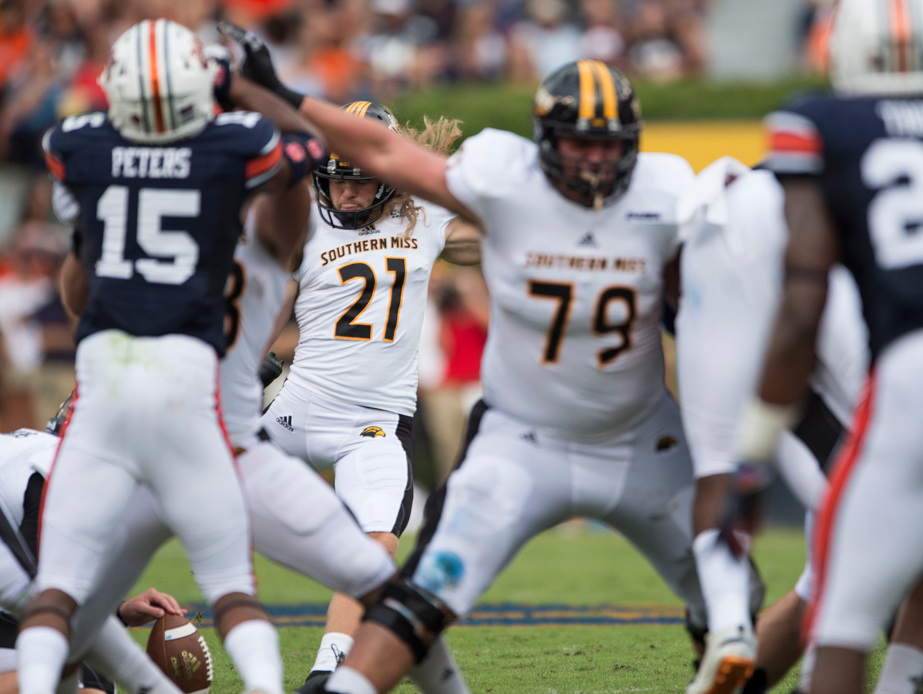 Southern Miss' Parker Shaunfield (21) kicks a field goal against  Auburn at Jordan-Hare Stadium in Auburn, Ala., on Saturday, Sept. 29, 2018. Auburn leads Southern Miss 14-3, the game went into a weather delay with 4:27 left in the second quarter.