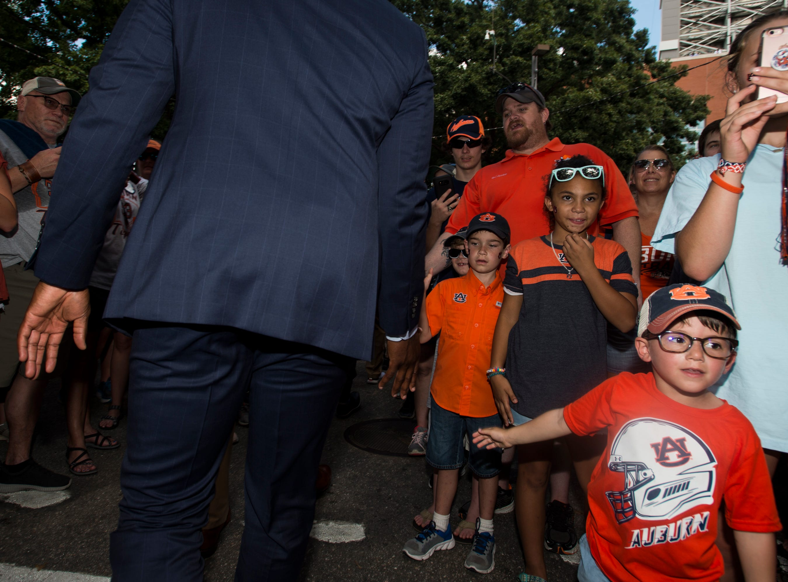 Fans high five players during the Tiger Walk outside Jordan-Hare Stadium in Auburn, Ala., on Saturday, Sept. 29, 2018.