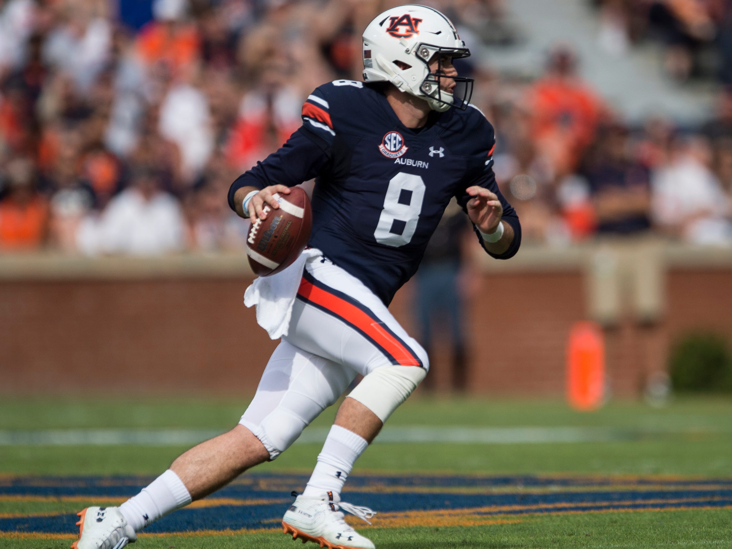 Auburn's Jarrett Stidham (8) scrambles out of the pocket against Southern Miss at Jordan-Hare Stadium in Auburn, Ala., on Saturday, Sept. 29, 2018. Auburn leads Southern Miss 14-3, the game went into a weather delay with 4:27 left in the second quarter.