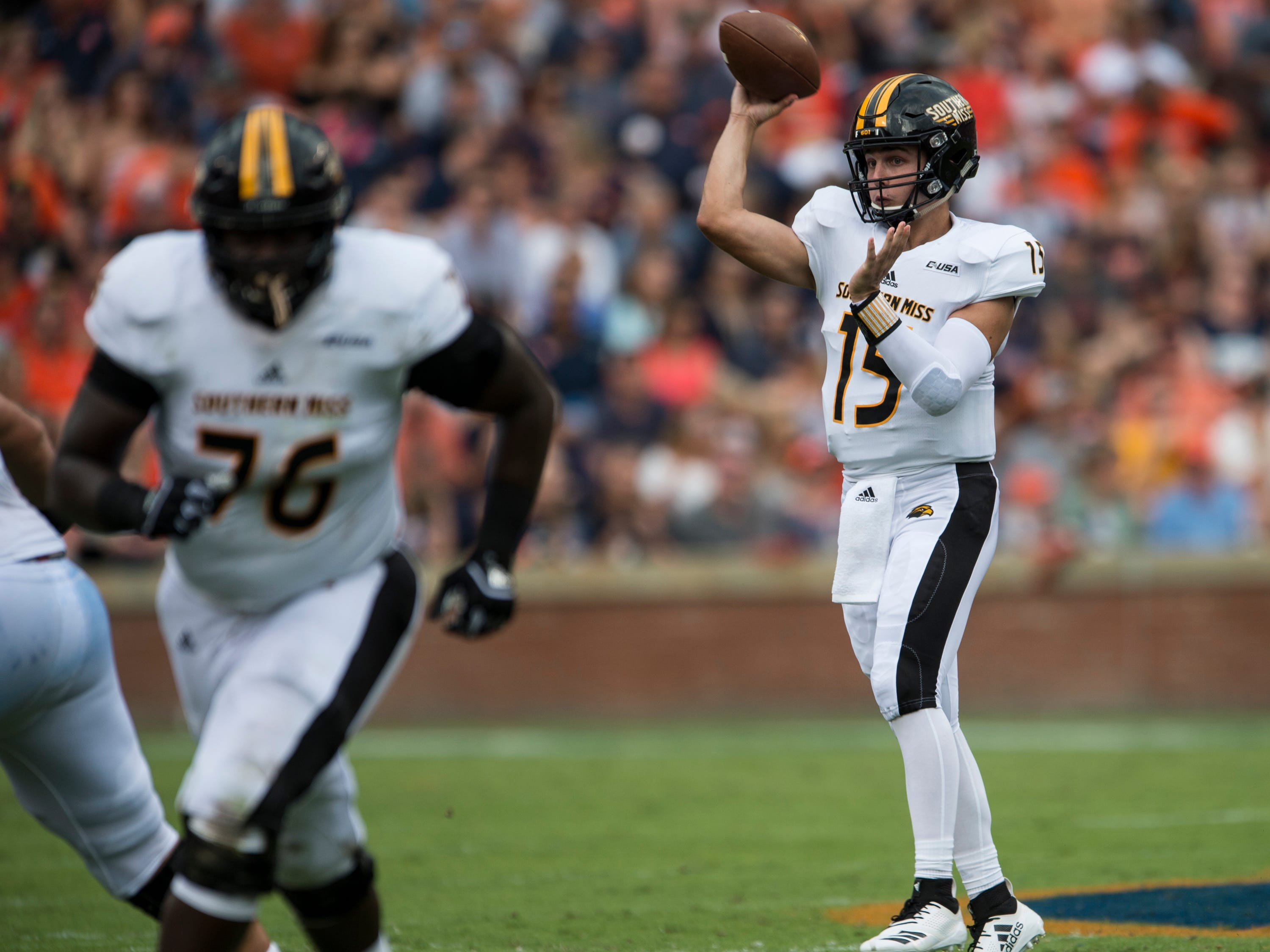 Southern Miss' Jack Abraham (15) throws the ball down the field against  Auburn at Jordan-Hare Stadium in Auburn, Ala., on Saturday, Sept. 29, 2018. Auburn leads Southern Miss 14-3, the game went into a weather delay with 4:27 left in the second quarter.