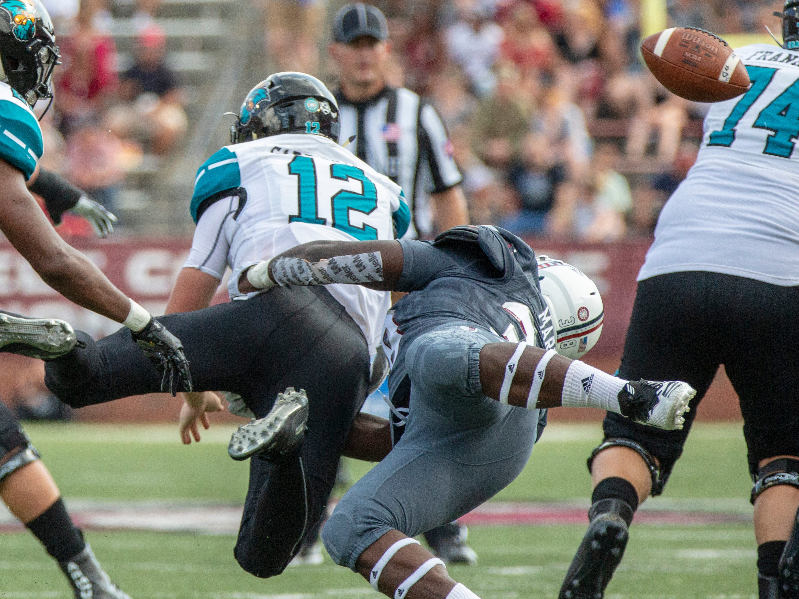 Troy's Jeremiah Jones sneaks up on an unsuspecting Bryce Carpenter for causing a fumble.