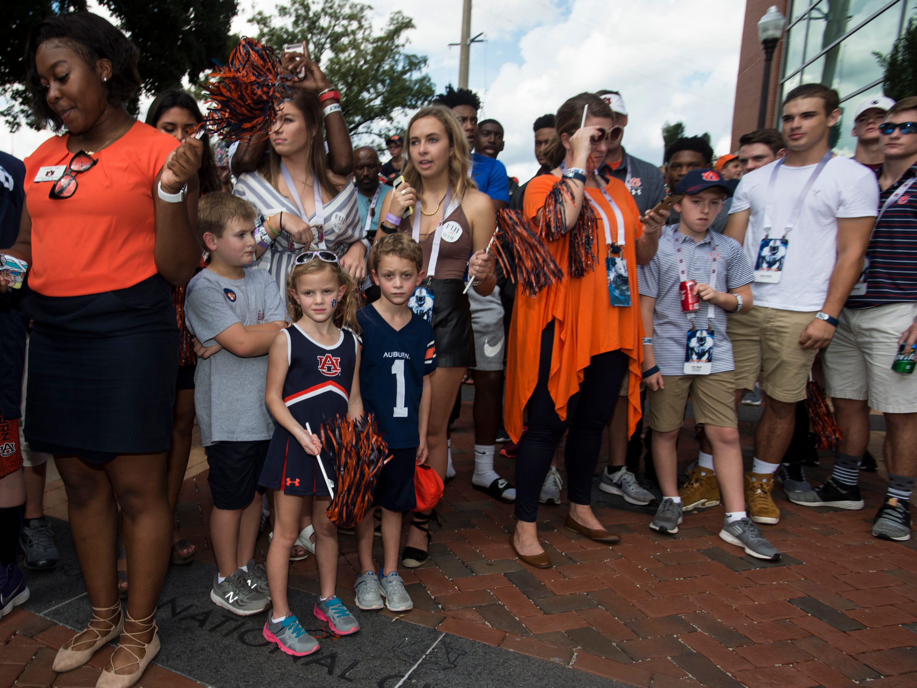 Fans wait for players to walk by during the Tiger Walk outside Jordan-Hare Stadium in Auburn, Ala., on Saturday, Sept. 29, 2018.