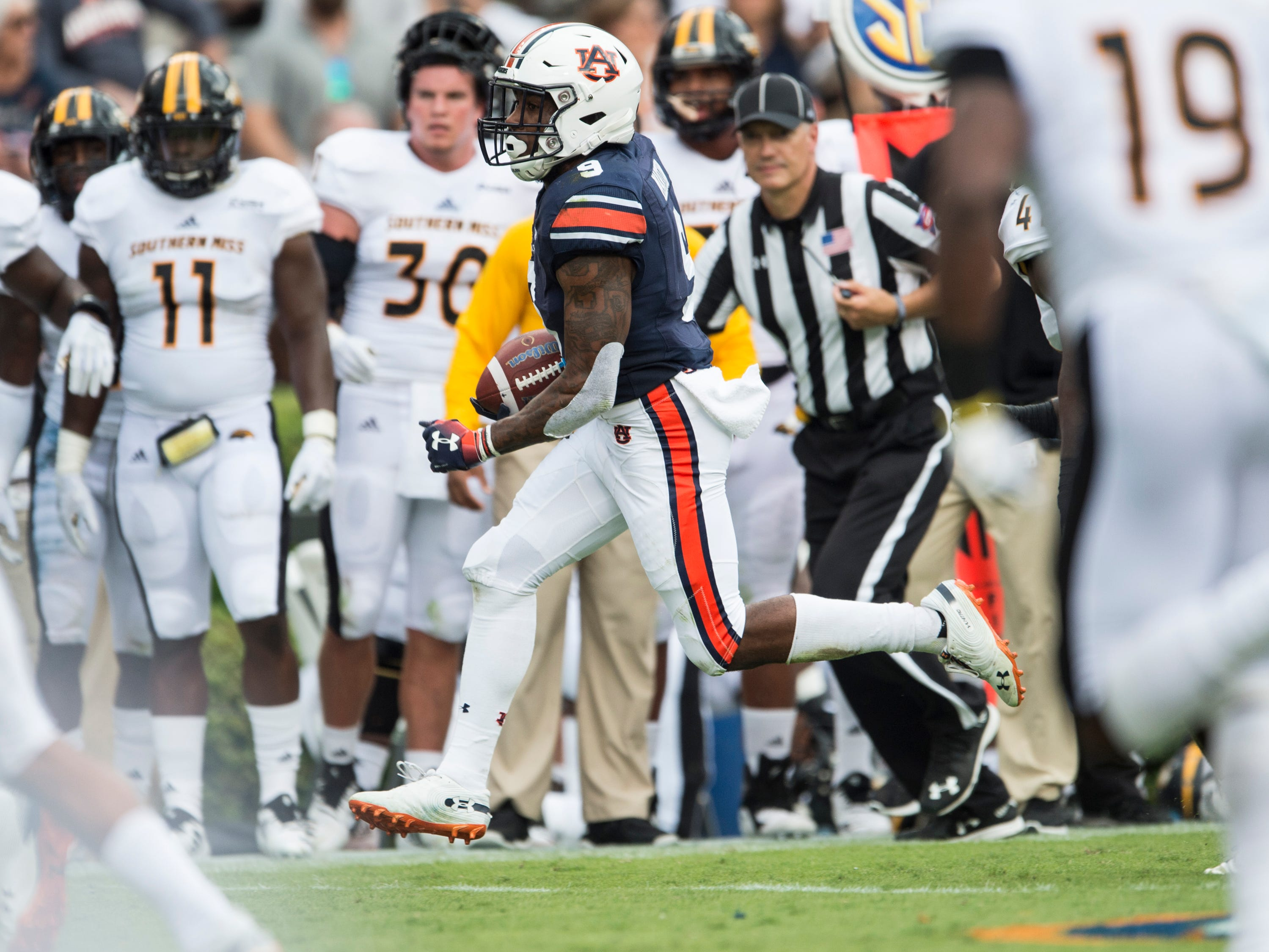 Auburn's Kam Martin (9) runs the ball down the field against Southern Miss at Jordan-Hare Stadium in Auburn, Ala., on Saturday, Sept. 29, 2018. Auburn leads Southern Miss 14-3, the game went into a weather delay with 4:27 left in the second quarter.