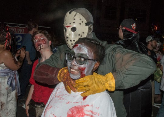 Jason, that's not how you hug the children. There were many kinds of dead walking in downtown Montgomery on Friday, Sept. 28, 2018, for  Montgomery Zombie Walk and Prom, which collected food and money donations for the Montgomery Area Food Bank.