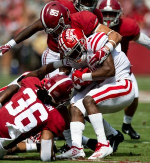 Alabama wide receiver Derek Kief (81) and linebacker Markail Benton (36) tackle Louisiana running back Raymond Calais (4)  on a kickoff return in first half action at Bryant-Denny Stadium in Tuscaloosa, Ala., on Saturday September 29, 2018.