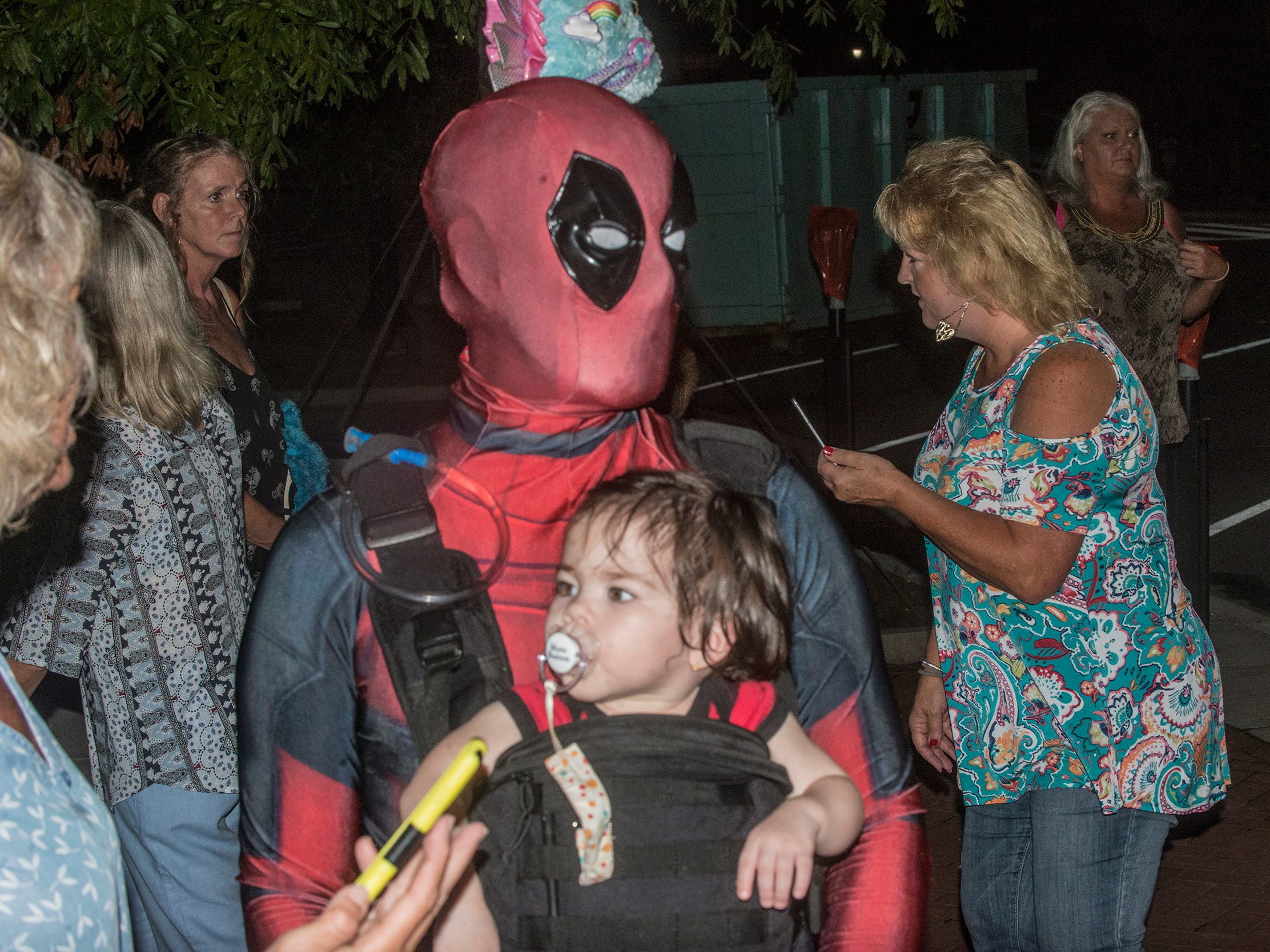 Joe Dormido, (Deadpool) with Felix, 16 months. There were many kinds of dead walking in downtown Montgomery on Friday, Sept. 28, 2018, for  Montgomery Zombie Walk and Prom, which collected food and money donations for the Montgomery Area Food Bank.