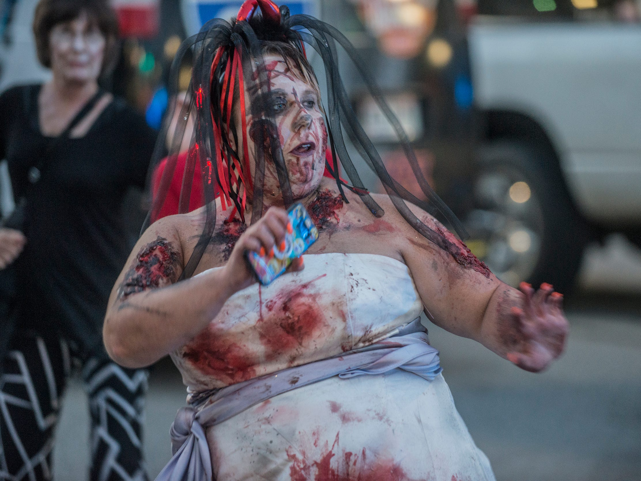 Latrisha Brooks was dancing in the street. There were many kinds of dead walking in downtown Montgomery on Friday, Sept. 28, 2018, for  Montgomery Zombie Walk and Prom, which collected food and money donations for the Montgomery Area Food Bank.