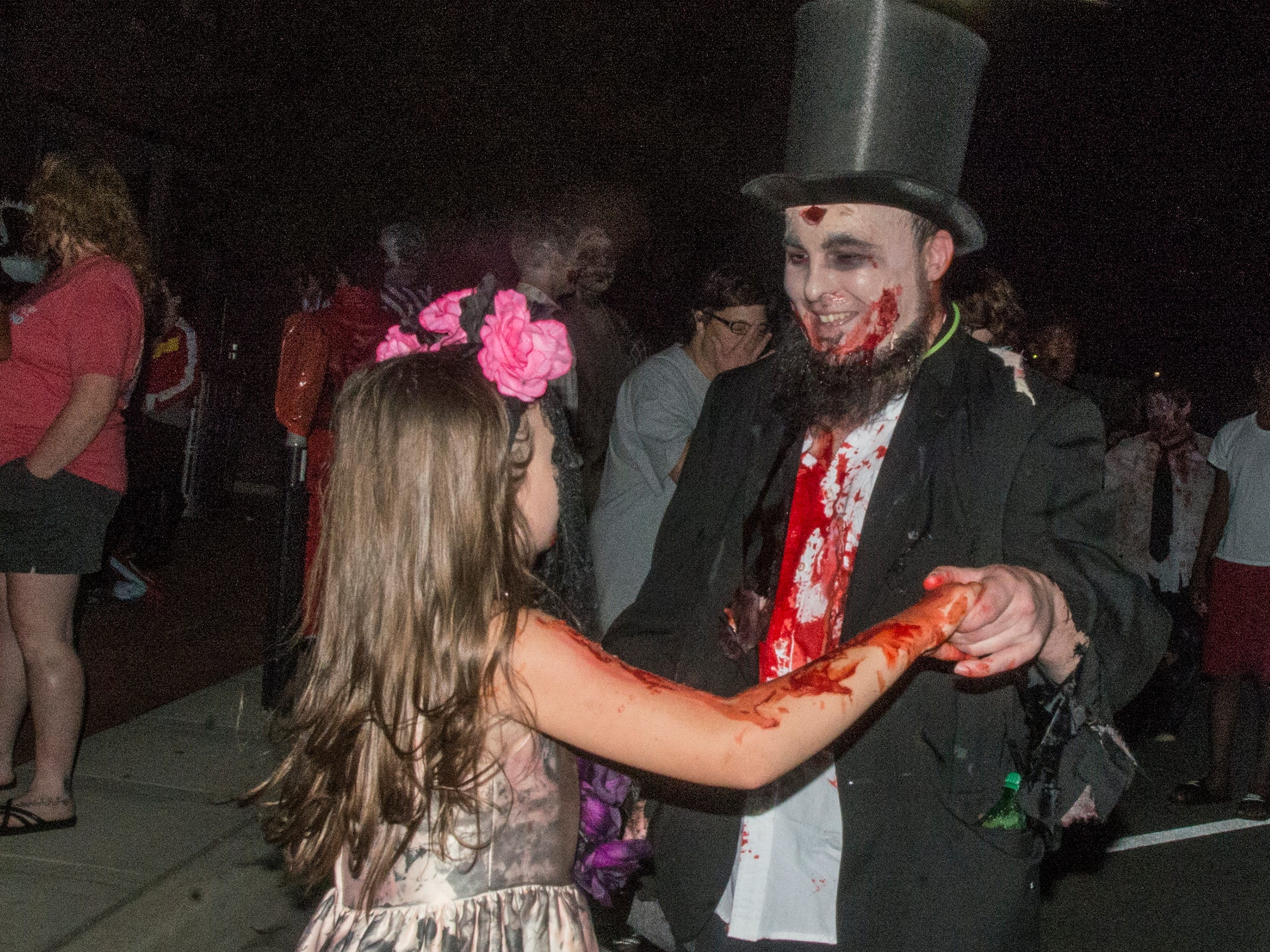 Zombie Lincoln can dance. There were many kinds of dead walking in downtown Montgomery on Friday, Sept. 28, 2018, for  Montgomery Zombie Walk and Prom, which collected food and money donations for the Montgomery Area Food Bank.