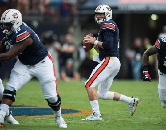 Auburn's Jarrett Stidham (8) looks to throw a pass against Southern Miss at Jordan-Hare Stadium in Auburn, Ala., on Saturday, Sept. 29, 2018. Auburn leads Southern Miss 14-3, the game went into a weather delay with 4:27 left in the second quarter.