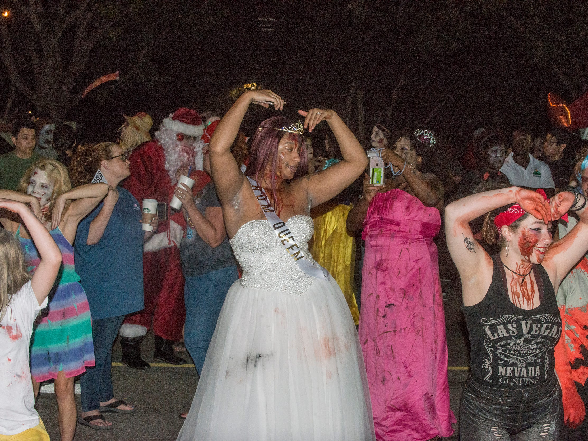 Doing the YMCA. There were many kinds of dead walking in downtown Montgomery on Friday, Sept. 28, 2018, for  Montgomery Zombie Walk and Prom, which collected food and money donations for the Montgomery Area Food Bank.
